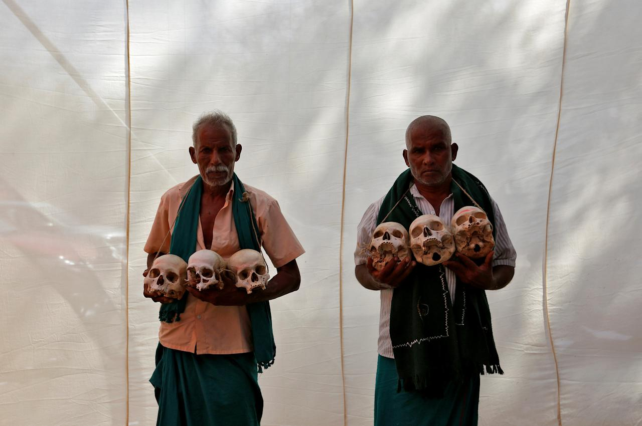 FILE PHOTO: Farmers from the southern state of Tamil Nadu display skulls, who they claim are the remains of Tamil farmers who have committed suicide, during a protest demanding a drought-relief package from the federal government, in New Delhi, India, March 22, 2017. REUTERS/Cathal McNaughton/File Photo