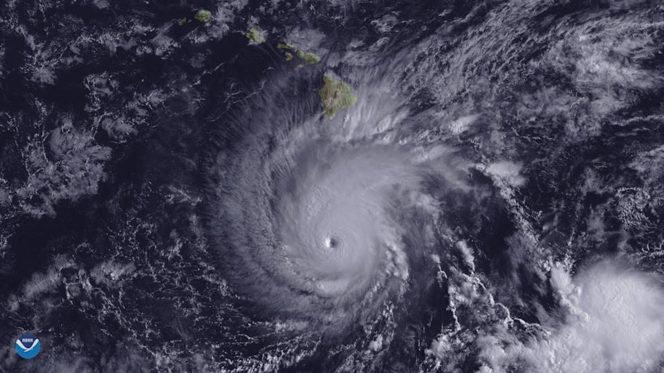 <p>Hurricane Lane, with a well-defined eye, is shown positioned about 300 miles south of Hawaii's Big Island at 2 p.m. ET on Aug. 22, 2018. (Photo: NOAA/Goes-East Imagery/Handout via Reuters) </p>
