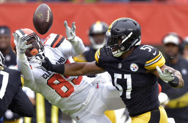 <p>Cleveland Browns tight end David Njoku (85) reaches but can't catch a pass under pressure from Pittsburgh Steelers long snapper Kameron Canaday (57) during the first half of an NFL football game, Sunday, Sept. 9, 2018, in Cleveland. (AP Photo/David Richard) </p>