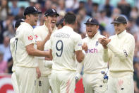 England's James Anderson is congratulated by the team on taking the wicket of India's KL Rahul on day three of the fourth Test match at The Oval cricket ground in London, Saturday, Sept. 4, 2021. (AP Photo/Kirsty Wigglesworth)