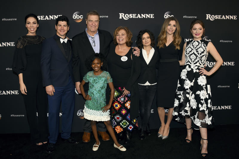 "FILE - In this March 23, 2018 file photo, from left, Whitney Cummings, Michael Fishman, John Goodman, Jayden Rey, Roseanne Barr, Sara Gilbert, Sarah Chalke and Emma Kenney arrive at the Los Angeles premiere of ""Roseanne"" in Burbank, Calif. ABC, which canceled its ""Roseanne"" revival over its star's racist tweet, said Thursday, June 21, 2018, it will air a Conner family sitcom minus Roseanne Barr this fall. (Photo by Jordan Strauss/Invision/AP, File)"