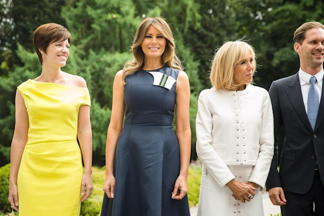 <p>For a meeting with state officials, including the French President and his wife, Melania decided on a navy blue dress by Calvin Klein which featured detail at the neck. <br><em>[Photo: Rex]</em> </p>