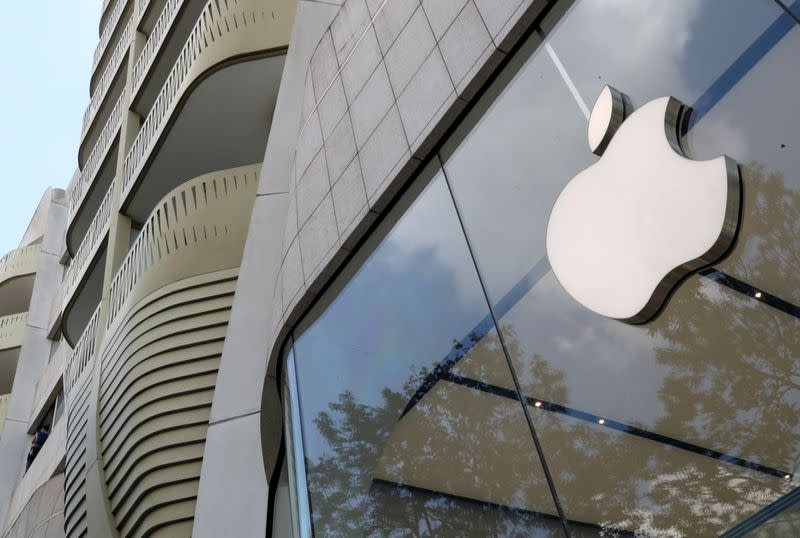 FILE PHOTO: The Apple Inc logo is seen at the entrance to the Apple store in Brussels