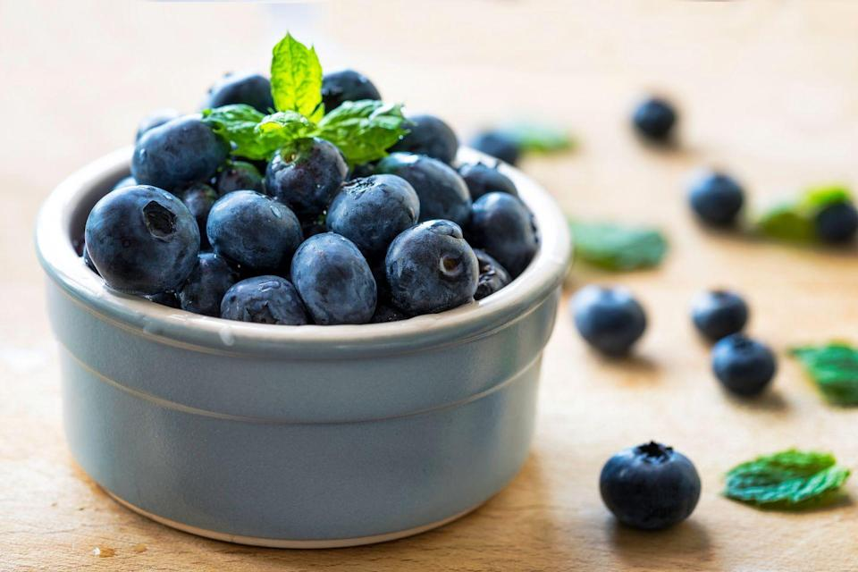 """<p>Blueberries <a href=""""https://www.womansday.com/relationships/a60945/best-friends-health-benefits/"""" rel=""""nofollow noopener"""" target=""""_blank"""" data-ylk=""""slk:improve memory"""" class=""""link rapid-noclick-resp"""">improve memory</a> by <a href=""""https://www.cbsnews.com/news/eating-blueberries-and-strawberries-staves-off-memory-decline-study-suggests/"""" rel=""""nofollow noopener"""" target=""""_blank"""" data-ylk=""""slk:protecting your brain"""" class=""""link rapid-noclick-resp"""">protecting your brain</a> from inflammation and boosting communication between brain cells.</p><p><strong>Recipe to try:</strong> <a href=""""https://www.womansday.com/food-recipes/food-drinks/recipes/a11904/cottage-cheese-pancakes-blueberry-compote-recipe-122830/"""" rel=""""nofollow noopener"""" target=""""_blank"""" data-ylk=""""slk:Cottage Cheese Pancakes with Blueberry Compote"""" class=""""link rapid-noclick-resp"""">Cottage Cheese Pancakes with Blueberry Compote</a></p>"""