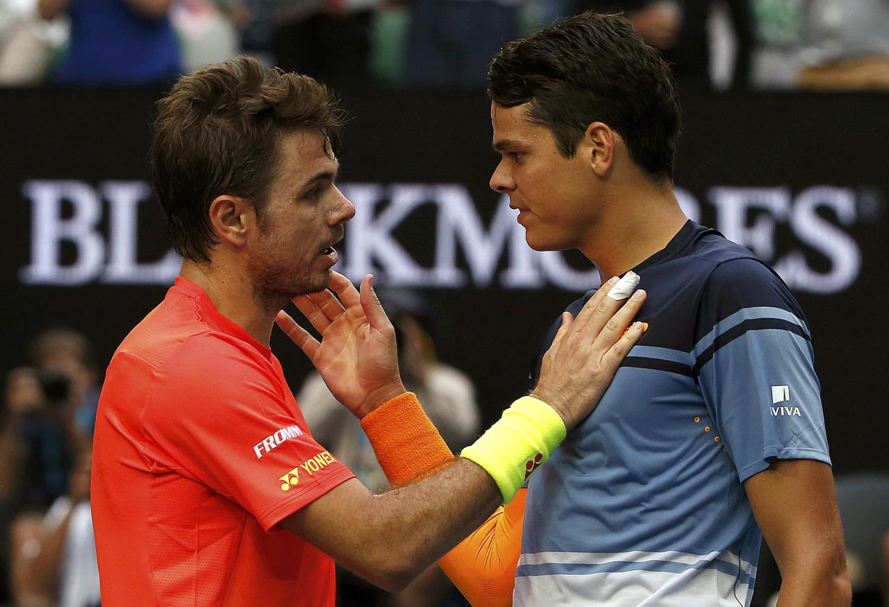 Canada's Raonic and Switzerland's Wawrinka speak at the net after Raonic won their fourth round match at the Australian Open tennis tournament at Melbourne Park