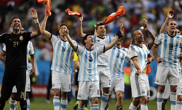 CORRECTS PHOTOGRAPHER'S BYLINE - Argentina's Lionel Messi and teammates celebrate at the end of the World Cup quarterfinal soccer match between Argentina and Belgium at the Estadio Nacional in Brasilia, Brazil, Saturday, July 5, 2014. Argentina won 1-0. (AP Photo/Eraldo Peres)