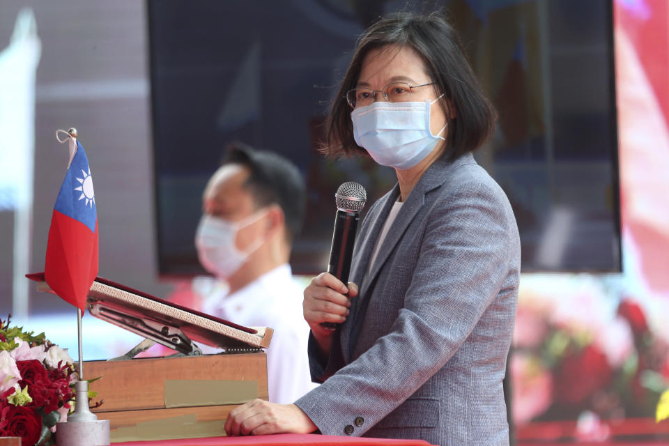 Taiwan's President Tsai Ing-wen delivers a speech during a launch ceremony for its first indigenous amphibious transport dock in Kaohsiung, southern Taiwan, Tuesday, April 13, 2021. (AP Photo/Chiang Ying-ying)