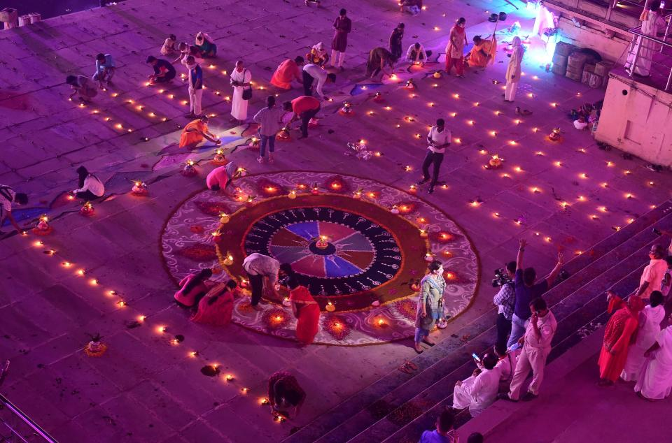 Hindu devotees light earthen lamps on the banks of the River Sarayu on the eve before the groundbreaking ceremony of the proposed Ram Temple in Ayodhya on August 4, 2020. - India's Prime Minister Narendra Modi will lay the foundation stone for a grand Hindu temple in a highly anticipated ceremony at a holy site that was bitterly contested by Muslims, officials said. The Supreme Court ruled in November 2019 that a temple could be built in Ayodhya, where Hindu zealots demolished a 460-year-old mosque in 1992. (Photo by SANJAY KANOJIA / AFP) (Photo by SANJAY KANOJIA/AFP via Getty Images)