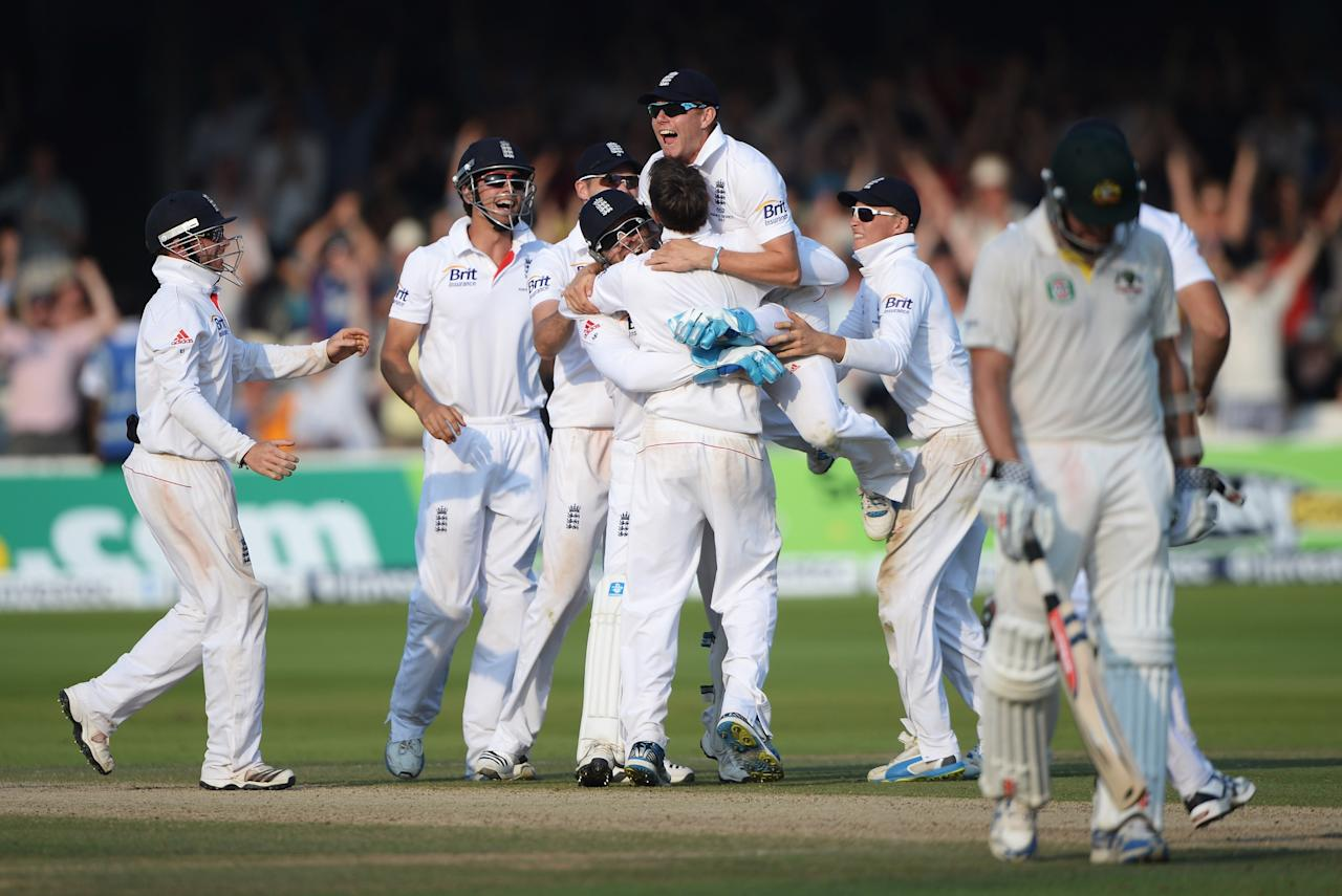 LONDON, ENGLAND - JULY 21: Graeme Swann of England is mobbed by team mates after taking the final wicket of James Pattinson of Australia giving England victory during day four of the 2nd Investec Ashes Test match between England and Australia at Lord's Cricket Ground on July 21, 2013 in London, England. (Photo by Gareth Copley/Getty Images)
