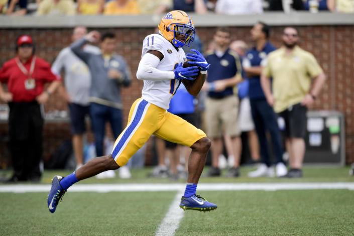 Pittsburgh wide receiver Taysir Mack (11) runs after making a catch during the first half of an NCAA college football game against Georgia Tech, Saturday, Oct. 2, 2021, in Atlanta. Mack scored a tochdown on the play. (AP Photo/Mike Stewart)