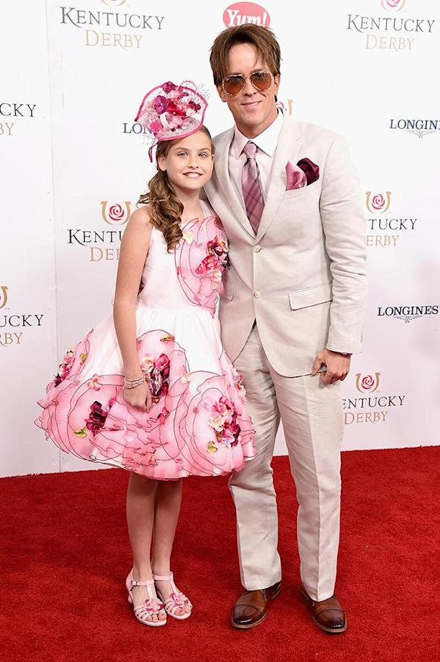 "<p><a href=""https://www.yahoo.com/celebrity/tagged/dannielynn-birkhead"" data-ylk=""slk:Dannielynn Birkhead"" class=""link rapid-noclick-resp"">Dannielynn Birkhead</a> made her seventh appearance at the Kentucky Derby, attending the 2017 event with her usual date, father <a href=""https://www.yahoo.com/celebrity/tagged/larry-birkhead"" data-ylk=""slk:Larry Birkhead"" class=""link rapid-noclick-resp"">Larry Birkhead</a>. To mark the special occasion, the 10-year-old daughter of <a href=""https://www.yahoo.com/celebrity/tagged/anna-nicole-smith"" data-ylk=""slk:Anna Nicole Smith"" class=""link rapid-noclick-resp"">Anna Nicole Smith</a> was festive as usual in her trademark color: pink. That hue happened to be a favorite of her mother's too. Dannielynn sported an knee-length floral frock with a bright pink fascinator that matched Larry's suit. (Photo: Michael Loccisano/Getty Images for Churchill Downs) </p>"
