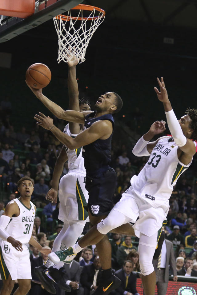 Butler guard Aaron Thompson, center, drives between Baylor guard Davion Mitchell, left, and forward Freddie Gillespie, right, in the first half of an NCAA college basketball game, Tuesday, Dec. 10, 2019, in Waco, Texas. (AP Photo/Rod Aydelotte)