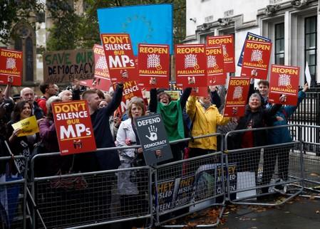 Demonstrators react on the ruling of the Supreme Court during a protest outside the Supreme Court in London