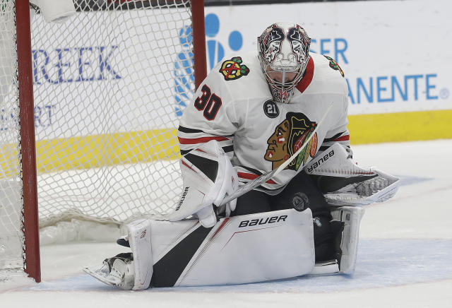 Chicago Blackhawks goaltender Cam Ward (30) defends a shot against the San Jose Sharks during the first period of an NHL hockey game in San Jose, Calif., Sunday, March 3, 2019. (AP Photo/Jeff Chiu)