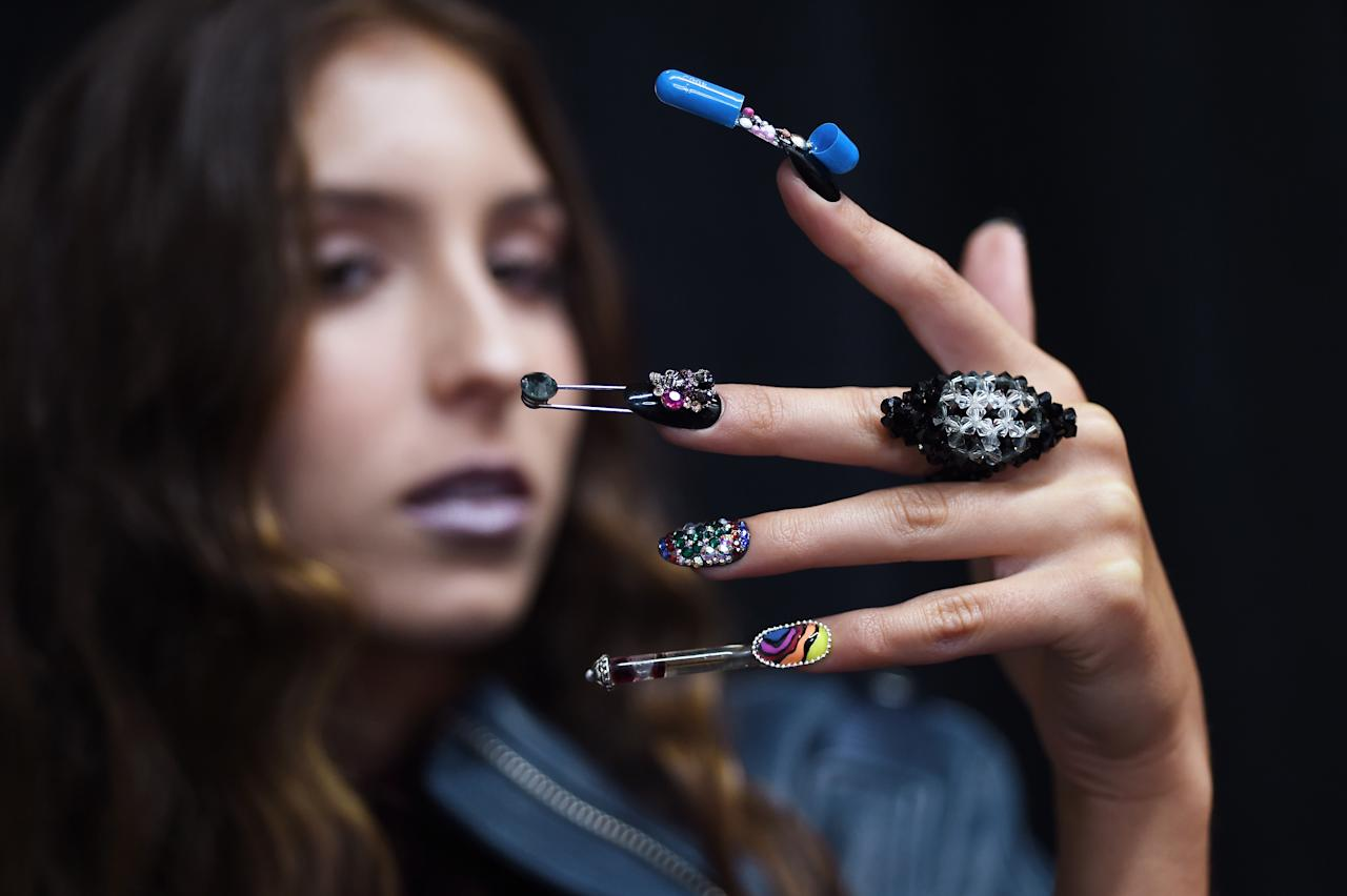 "<p>CND co-founder and creative director Jan Arnold and CND creative lead Heather Reynosa, ""created 3-D nail designs that were both sculptural and functional full of skulls and safety pins, punk appliques, and wild spirals."" (Photo: CND) </p>"