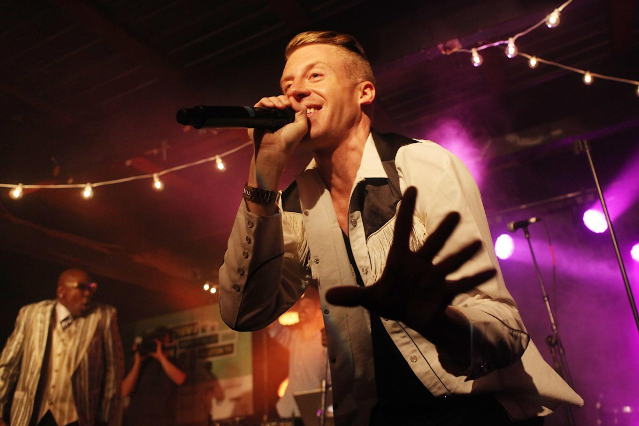 AUSTIN, TX - MARCH 12:  Macklemore performs onstage at the iHeartRadio Official SXSW Showcase on March 12, 2013 in Austin, Texas.  (Photo by Roger Kisby/Getty Images for iHeartradio)