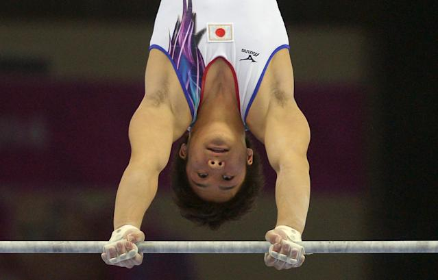 Gold medalist Japan's Kamoto Yuya performs on the horizontal bar during the artistic gymnastics men's individual all-around final of the 2014 Asian Games in Incheon on September 23, 2014 (AFP Photo/Pornchair Kittiwongsakul )