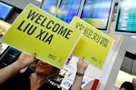 Amnesty International activists hold up placards welcoming Liu Xia, the widow of Chinese Nobel Peace Prize laureate Liu Xiaobo, in Berlin