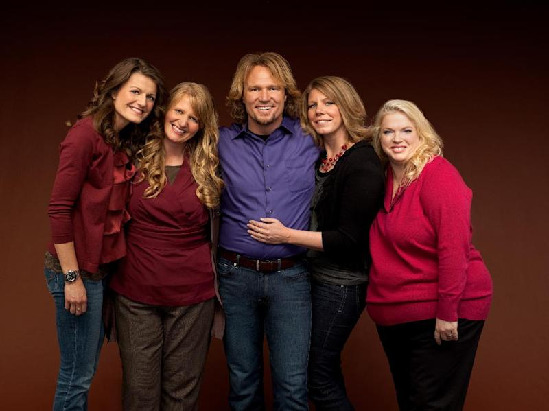"FILE - In this publicity file image provided by TLC, Kody Brown, center, poses with his wives, from left,  Robyn, Christine, Meri and Janelle in a promotional photo for the reality series, ""Sister Wives."" The polygamous family made famous on the TLC show  is asking a U.S. judge not to block their challenge of Utah's bigamy law. Kody Brown and wives Meri, Janelle, Christine and Robyn filed a lawsuit in Salt Lake City's U.S. District Court in July 2011. The stars say the law is unconstitutional because it prohibits them from living together and criminalizes their private sexual relationships.  (AP Photo/TLC, George Lange, File)"