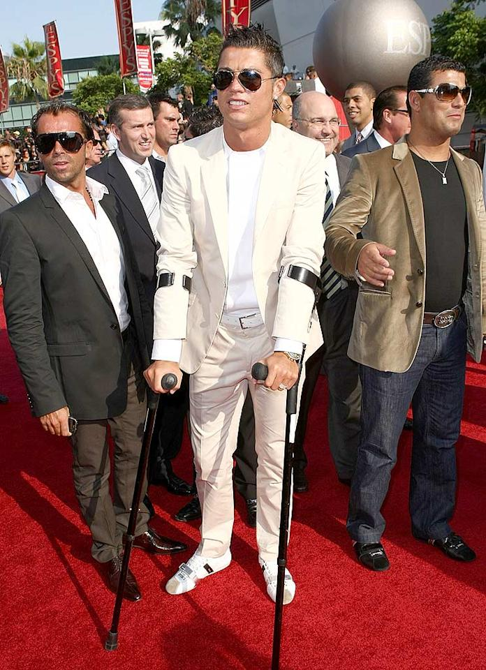 """Portuguese soccer stud Cristiano Ronaldo, who recently had ankle surgery, still looked hot as he hobbled down the red carpet on crutches. John Shearer/<a href=""""http://www.wireimage.com"""" target=""""new"""">WireImage.com</a> - July 16, 2008"""