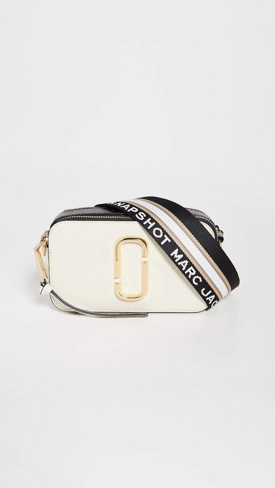 """<p><strong>The Marc Jacobs</strong></p><p>shopbop.com</p><p><strong>$295.00</strong></p><p><a href=""""https://go.redirectingat.com?id=74968X1596630&url=https%3A%2F%2Fwww.shopbop.com%2Fsnapshot-camera-bag-marc-jacobs%2Fvp%2Fv%3D1%2F1524043672.htm&sref=https%3A%2F%2Fwww.seventeen.com%2Flife%2Ffriends-family%2Fg722%2Fbest-holiday-gifts-for-mom%2F"""" rel=""""nofollow noopener"""" target=""""_blank"""" data-ylk=""""slk:Shop Now"""" class=""""link rapid-noclick-resp"""">Shop Now</a></p><p>Between the subtle logo, classic color, and simplistic shape, this baby will match every item in mom's closet. Incidentally, it'll also look cute with everything you own. What a coincidence!</p>"""