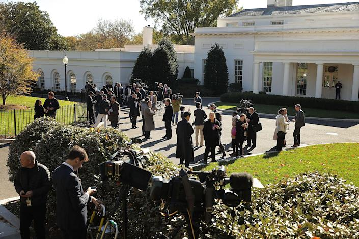 <p>Journalists gather on the driveway in front of the West Wing in anticipation of the arrival of President-elect Donald Trump for a meeting at the White House, Nov. 10, 2016, in Washington, D.C. (Chip Somodevilla/Getty Images) </p>