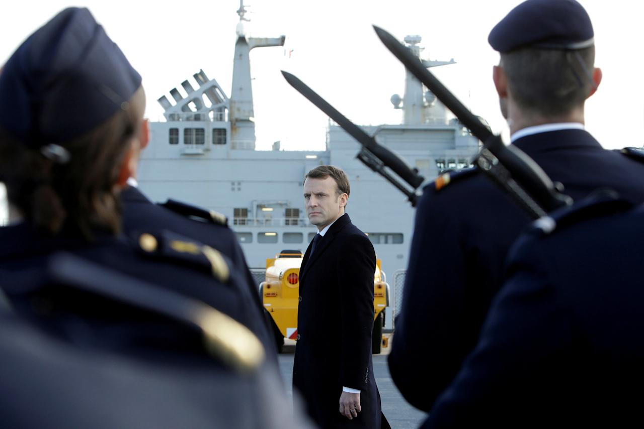 French President Emmanuel Macron reviews an honor guard upon his arrival on board of the French war ship Dixmude docked in the French Navy base of Toulon, southern France, before delivering a speech to present his New Year's wishes to the French Army, January 19, 2018. REUTERS/Claude Paris/Pool     TPX IMAGES OF THE DAY