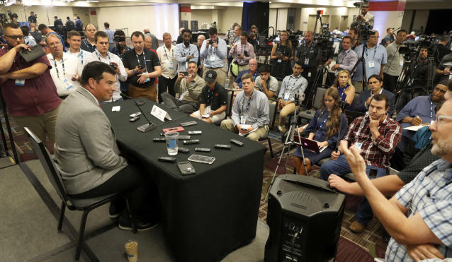 Ohio State head coach Ryan Day, left, talks to reporters during the Big Ten Conference NCAA college football media days Thursday, July 18, 2019, in Chicago. (AP Photo/Charles Rex Arbogast)