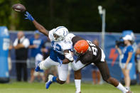 Indianapolis Colts defensive back Rolan Milligan (42) breaks up a pass toe Cleveland Browns tight end Demetrius Harris (88) during practice at the NFL team's football training camp in Westfield, Ind., Thursday, Aug. 15, 2019. (AP Photo/Michael Conroy)