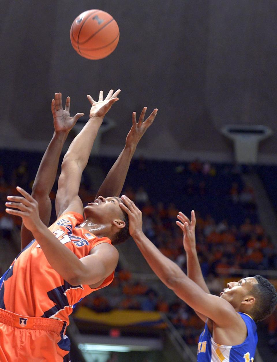 Illinois' guard Malcolm Hill (21) goes up for a shot in front of Coppin State's guard Christian Kessee (10) during an NCAA college basketball game in Champaign, Ill., Sunday, Nov. 16, 2014. (AP Photo/Robin Scholz)