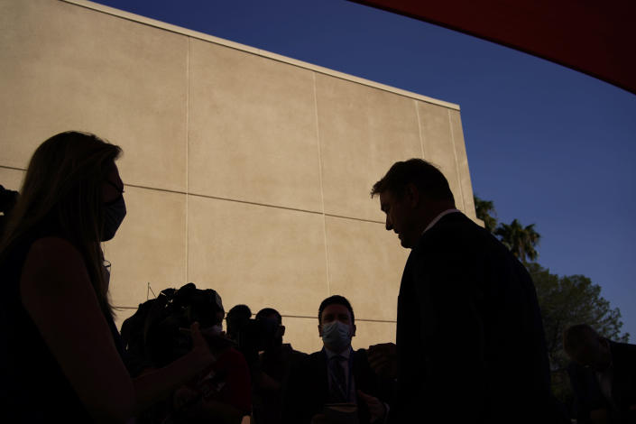 Former U.S. Sen. Dean Heller, right, speaks with the media at an event at Share Village Las Vegas after announcing a bid for governor of Nevada, Monday, Sept. 20, 2021, in Las Vegas. (AP Photo/John Locher)