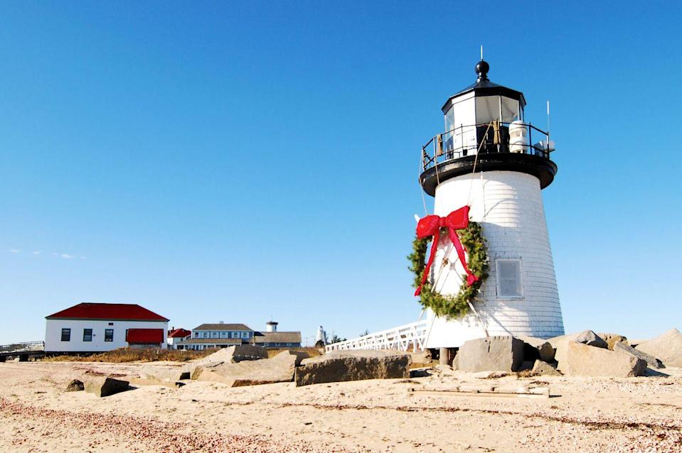 """<p>Nantucket is a premier destination for the summer, but it has some fun Christmas activities during its off-season, too. The town hosts its annual <a href=""""https://christmasstroll.com/"""" rel=""""nofollow noopener"""" target=""""_blank"""" data-ylk=""""slk:Christmas Stroll"""" class=""""link rapid-noclick-resp"""">Christmas Stroll</a> the first weekend of December. The Stroll's founders began the event in an effort to encourage their fellow residents to shop local, instead of heading to Cape Cod for big stores. During the weekend, hundreds of decorates Christmas trees line downtown streets, carolers sing in costume, and Santa arrives at the wharves via Coast Guard Cutter. </p>"""