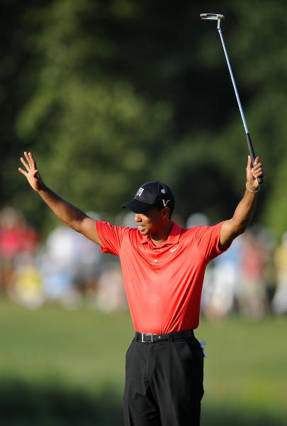 Tiger Woods reacts on the 18th green after winning the AT&T National golf tournament at Congressional Country Club in Bethesda, Md., Sunday, July 1, 2012. (AP Photo/Nick Wass)