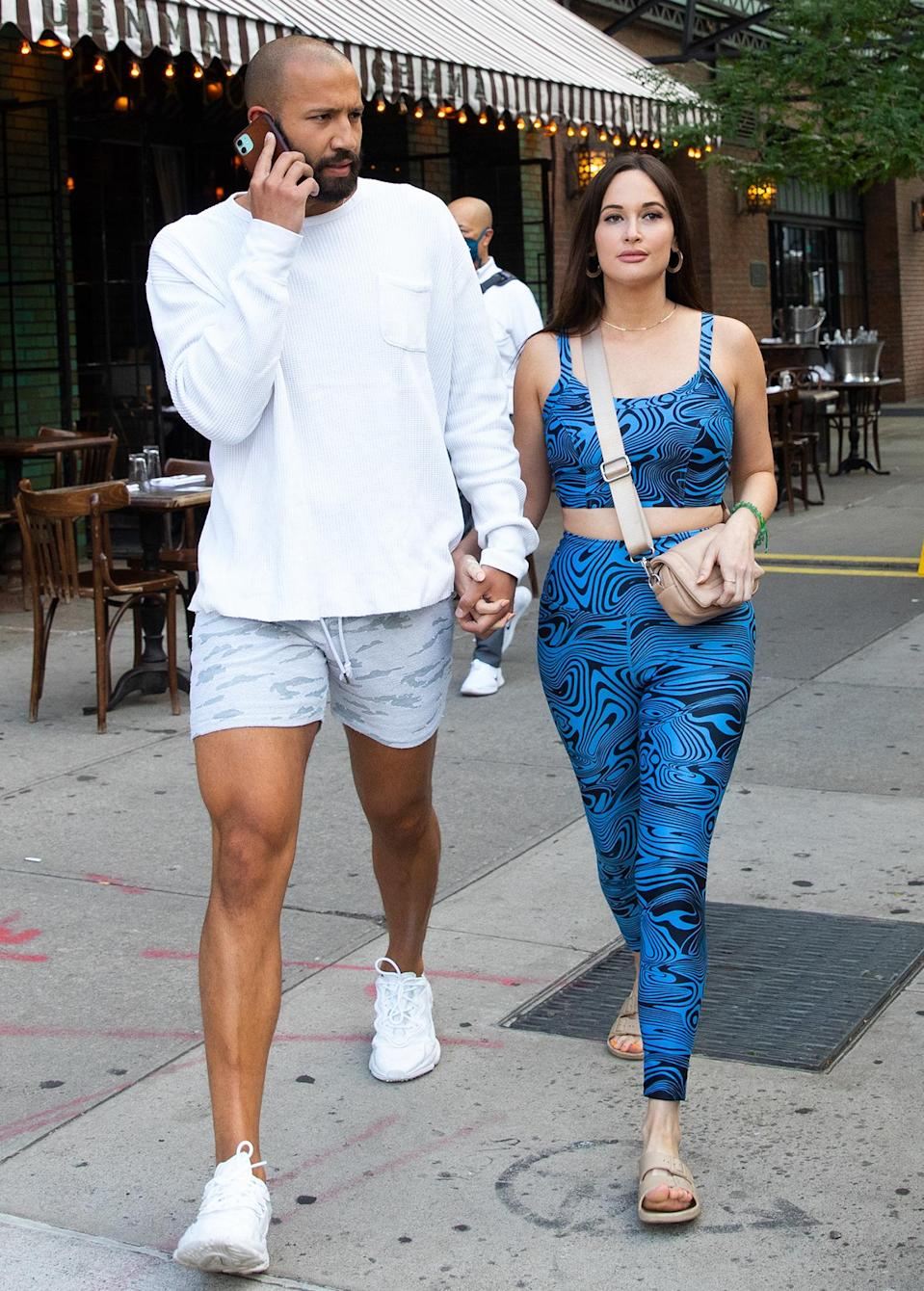 <p>Kacey Musgraves and rumored new boyfriend Cole Schafer stroll hand-in-hand through N.Y.C. on June 20.</p>