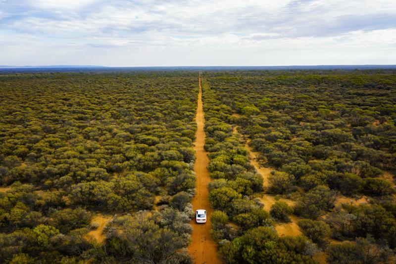 Driving through the bush land in Australian outback, Western Australia