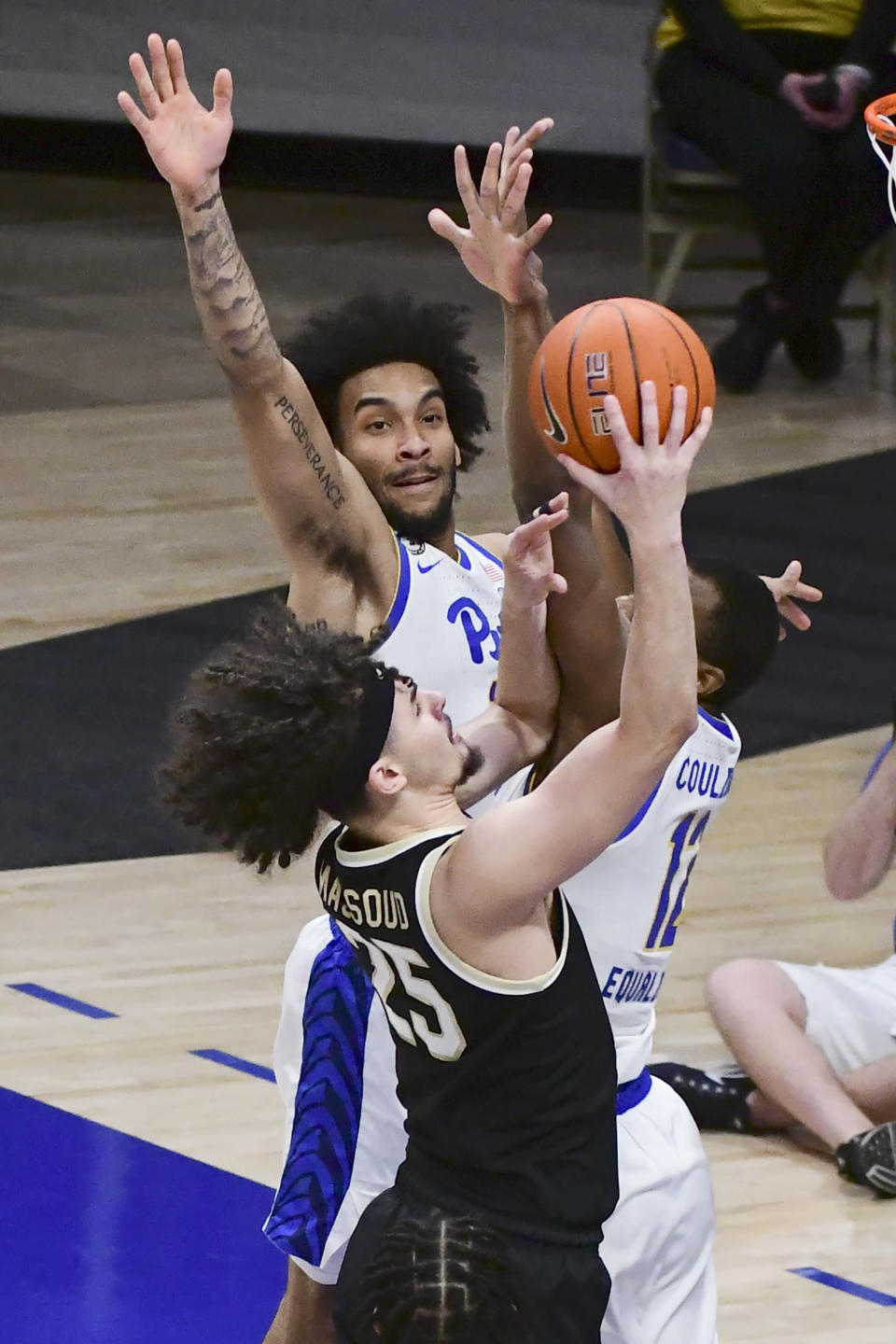 Wake Forest forward Ismael Massoud drives past Pittsburgh forward Justin Champagnie during the first half of an NCAA college basketball game, Tuesday, March 2, 2021, in Pittsburgh. (AP Photo/Fred Vuich)