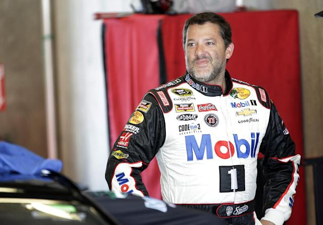 Driver Tony Stewart reacts during practice for the Brickyard 400 Sprint Cup series auto race at the Indianapolis Motor Speedway in Indianapolis, Saturday, July 26, 2014. (AP Photo/AJ Mast)