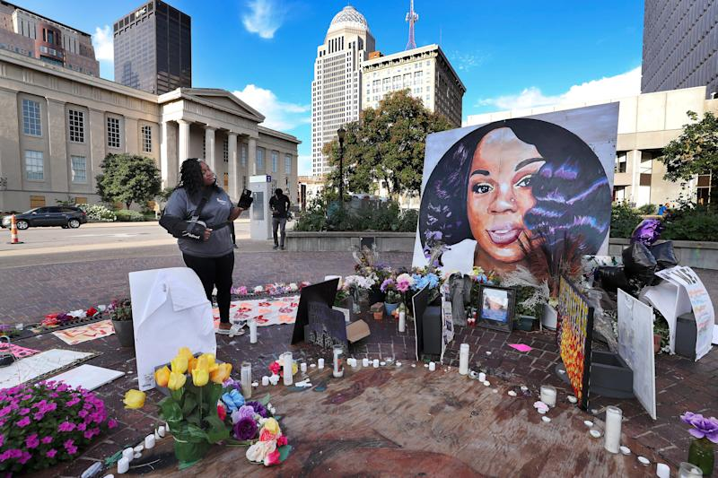 Tamika Palmer admired a large painting of her slain daughter, Breonna Taylor, that is displayed inside Breonna's Circle at Jefferson Square Park on Aug. 5 2020. She died at the hands of LMPD as they issued a no-knock warrant at her apartment.