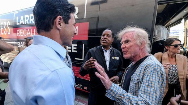 PHOTO: Republican conservative radio show host Larry Elder, center, argues with a TV reporter during an interview after visiting a deli during a campaign for the California gubernatorial recall election on Monday, Sept. 13, 2021, in Los Angeles. (Ringo H.W. Chiu/AP)