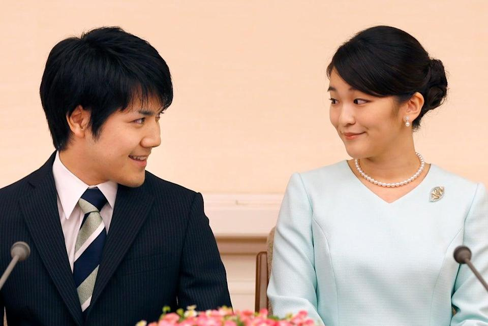 Princess Mako and her fiance Kei Komuro smile during a press conference to announce their engagement at the Akasaka East Residence in Tokyo in 2017 (AFP via Getty Images)