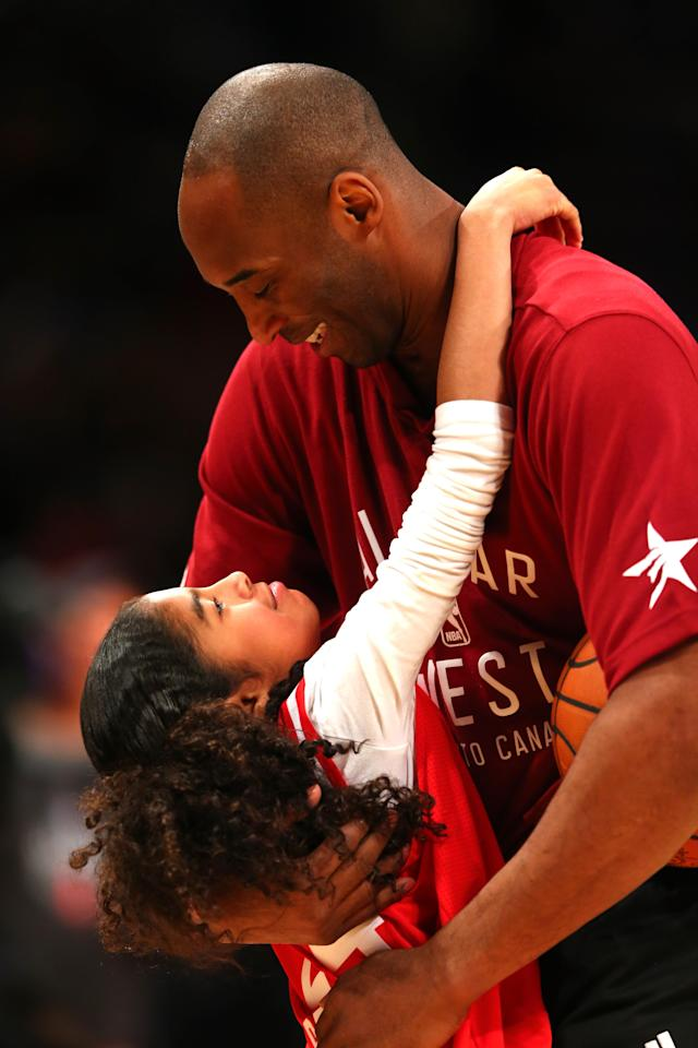 Kobe Bryant #24 of the Los Angeles Lakers and the Western Conference warms up with daughter Gianna Bryant during the NBA All-Star Game 2016 at the Air Canada Centre on February 14, 2016 in Toronto, Ontario. (Photo by Elsa/Getty Images)