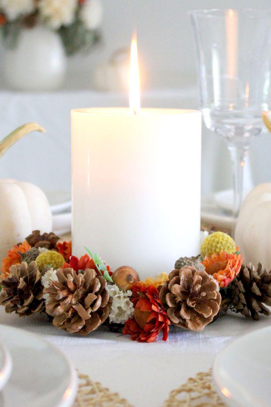 """<p>It's easy to forget to decorate areas like your coffee table, which is why we love this miniature wreath. You can make this craft in minutes and display with a candle just about anywhere.</p><p><strong>Get the tutorial at <a href=""""https://tonalitydesigns.com/diy-fall-candle-wreaths/"""" rel=""""nofollow noopener"""" target=""""_blank"""" data-ylk=""""slk:Tonality Designs"""" class=""""link rapid-noclick-resp"""">Tonality Designs</a>.</strong></p><p><strong><a class=""""link rapid-noclick-resp"""" href=""""https://www.amazon.com/Coobey-Christmas-PineCones-Ornament-Decoration/dp/B077BH8X5H/?tag=syn-yahoo-20&ascsubtag=%5Bartid%7C10050.g.1371%5Bsrc%7Cyahoo-us"""" rel=""""nofollow noopener"""" target=""""_blank"""" data-ylk=""""slk:SHOP PINECONES"""">SHOP PINECONES</a><br></strong></p>"""