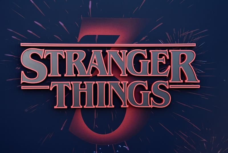 "Stranger Things logo seen on the backdrop of Netflix's ""Stranger Things 3"" premiere at Santa Monica high school Barnum Hall on June 28, 2019 in Santa Monica, California. (Photo by Chris Delmas / AFP) (Photo credit should read CHRIS DELMAS/AFP/Getty Images)"
