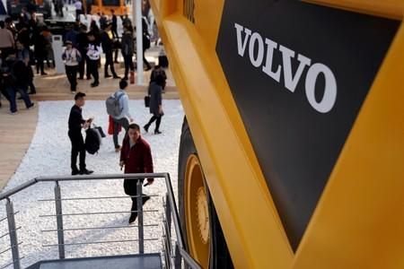 FILE PHOTO: People visit heavy machinery of Volvo at Bauma China, the International Trade Fair for Construction Machinery in Shanghai