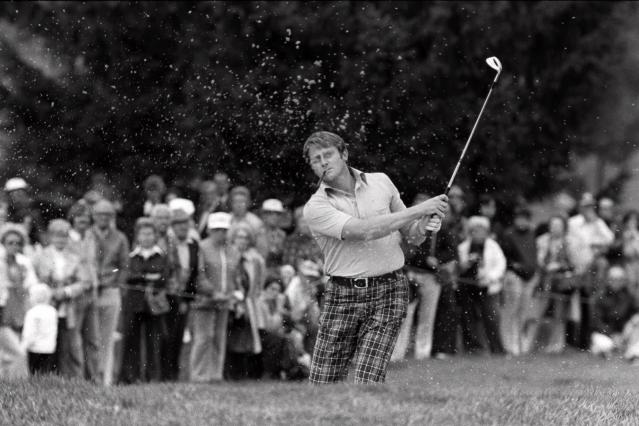 FILE - In this Sept. 21, 1975 file photo, Britain's Brian Barnes, pipe in mouth, follows through after blasting out of a sand trap during Ryder Cup match at Laurel Valley Golf Club, Ligonier, Pa. Barnes, the charismatic English golfer who beat Jack Nicklaus twice in one day in Ryder Cup singles matches, has died after a short illness. He was 74. The European Tour said Barnes, who had cancer, died on Monday, Sept. 9, 2019 with family members by his side. (AP Photo/RAD, file)