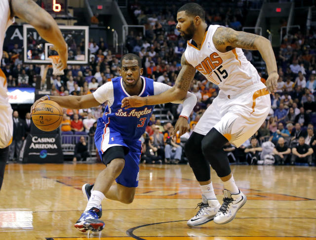 Los Angeles Clippers guard Chris Paul (3) drives as Phoenix Suns forward Marcus Morris (15) defends during the first half of an NBA basketball game on Wednesday, April 2, 2014, in Phoenix. (AP Photo/Matt York)