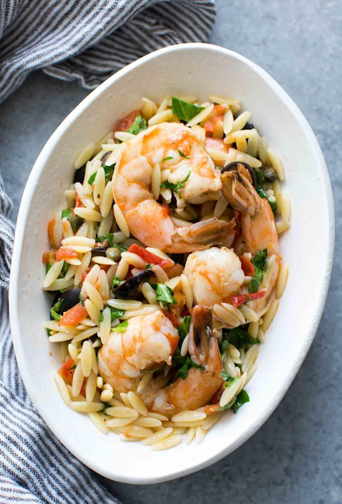 """<strong>Get the <a href=""""http://www.simplyrecipes.com/recipes/shrimp_with_olives_tomatoes_and_orzo/"""" rel=""""nofollow noopener"""" target=""""_blank"""" data-ylk=""""slk:Shrimp with Olives, Tomatoes, and Orzo recipe"""" class=""""link rapid-noclick-resp"""">Shrimp with Olives, Tomatoes, and Orzo recipe</a>&nbsp;from Simply Recipes</strong>"""