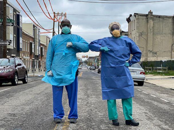 PHOTO: Dr. Ala Stanford stands on street with a colleague. (Pastor Marshall Mitchell via Black Doctors Covid19 Consortium)