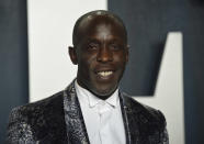"""FILE - In this Sunday, Feb. 9, 2020, file photo, Michael K. Williams arrives at the Vanity Fair Oscar Party in Beverly Hills, Calif. Williams, who played the beloved character Omar Little on """"The Wire,"""" has died. New York City police say Williams was found dead Monday, Sept. 6, 2021, at his apartment in Brooklyn. He was 54. (Photo by Evan Agostini/Invision/AP, File)"""