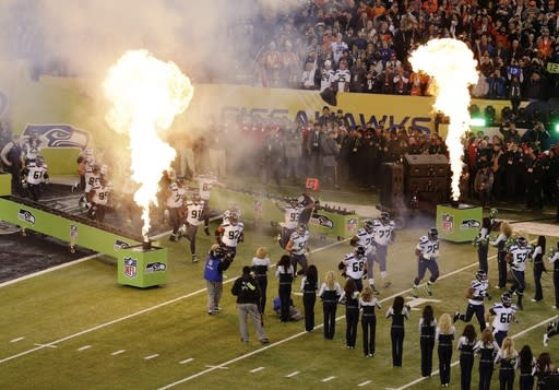 The Seattle Seahawks run on to the field for the NFL Super Bowl XLVIII football game against the Denver Broncos Sunday, Feb. 2, 2014, in East Rutherford, N.J. (AP Photo/Charlie Riedel)
